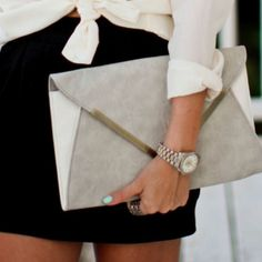 I like over-sized clutches for fancy events. It's big enough to hold he necessities, but not too big to be burdensome. I think over-sized clutches should all come with a long chain so that, when used, the bag sides on the lower hip.