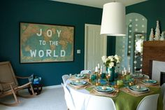 Festive dining room:  While the message shown here is seasonal, the stenciled map easily could translate into everyday decor.  ||  Emily Henderson via apartment therapy