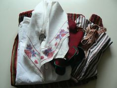 """Skedevi, Östergötland, $299 on ebay: Red bodice w green edge-trimming, a white rust-red skirt, an apron w stripes on white ground, a cotton blouse, a hand embroidered scarf, a brooch & red tights.    Bodice has been repaired or needs to be repaired (the three last close-up pictures.)  Apron: 29"""" long and 26"""" wide Blouse: length 20"""", breast 42"""" Bodice: breast 36,5"""", length 18"""" Skirt: 36"""" long, waist 26"""", 76"""" wide (notice in pics that the waist size has been altered & can easily altered…"""