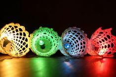 crocheted bells used as light covers - Ravelry has the pattern $4.00 - the bells look like badminton shuttles - i wonder if you could make this work, a lot less time