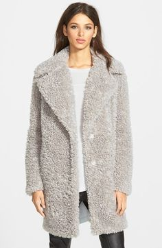 An oversized notch collar tops a versatile three-quarter coat that wraps you in soft and plush faux fur that's as huggable as you know what.