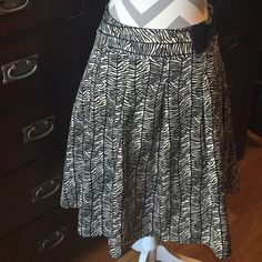 Apt. 9 Skirt with Side Bow 100% polyester. Lined.  Zips on the left side. Apt. 9 Skirts
