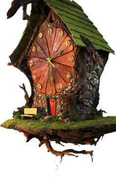 Each house from The Enchanted World of Fairy Woodland begins its life in a bed of sand – that's where the twigs are glued together to make the framework for the walls. When the cold processed porcelain is poured into the frame, over the stones, the sand adheres to it and helps form the walls. (interesting construction technique ... poured cold porcelain into sand over twig frame?)