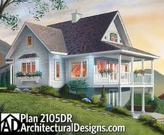 The daylight basement on this vacation home plan, which is designed for a sloping lot, offers the opportunity for expansion. A covered porch off the living area allows easy indoor-outdoor entertaining.