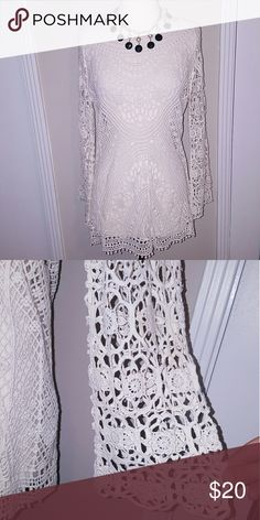 NWOT Ivory crochet bell sleeves tunic top Very beautiful detailing throughout and never been worn. Pair with a matching cami underneath. Fits size small, too. Necklace is for sale in another listing. Forever 21 Tops Tunics