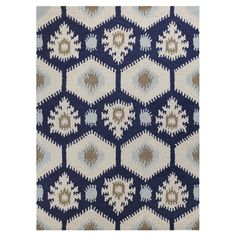 A stylish anchor for a vibrant space or touch of texture in a neutral room, this hand-tufted wool rug features an ikat-inspired motif in ivory and navy....