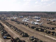 Vehicle Graveyard inside the Chernobyl Zone and some tanks used during the cleanup of Chernobyl, Ukraine