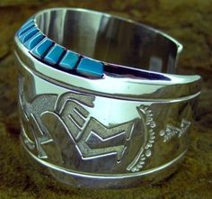 Beautiful wide kokopelli sterling silver/ coral and turquoise cuff bracelet.