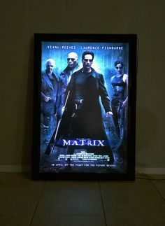 using LED strips and a dimmer to create a backlit movie poster, theater style