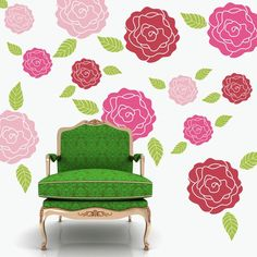 green chair and rose wall