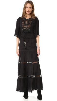 Beaded tassels and tonal lace enhance the bohemian look of this Cleobella maxi dress. Deep side slits keep the fit relaxed. Drawstring waistband. Half sleeves. Hook-and-eye front keyhole. Unlined.