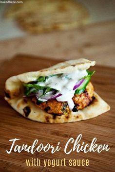 This Tandoori Chicken Burger with yogurt sauce is easy to make, super fast, and pretty darn tasty if I do say so myself. I have seen a lot of tandoori recipes around lately in the food magazines and the blogs, and I took about 3 or 4 different recipes and came up with this one. #chicken #burgers #tandoori #dinner #recipe #groundchicken #tandoorichickenrecipe #yogurtsauce #