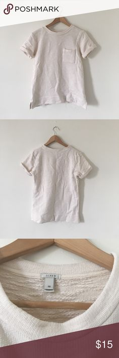 J. Crew Summerweight Boyfriend Sweatshirt Cream short sleeve sweatshirt great for transition months and layering! Pocket detail. A little wrinkled but otherwise excellent condition. 100% cotton with a loose/oversized fit. Could work for a Small too. J. Crew Tops Sweatshirts & Hoodies