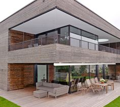Modern house in kebony, concrete and stone work