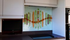 This beautiful bespoke fused glass splashback was delivered to a house in Malpas, Chester. The design is a fresh take on a classic, which is our widely loved Dalaman design, but the colours and details are completely original and unique to this piece. The background is a desaturated hue to match the neutral modern décor of the kitchen cabinets that surround the space. Splashback, Fused Glass Art, Panel Art, Chester, All Design, Modern Decor, Hue, Bespoke, Neutral