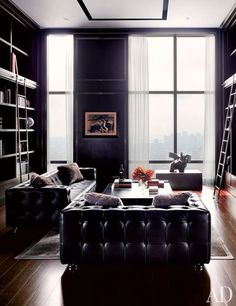 In a Manhattan penthouse by ODA-Architecture, a work by Picasso hangs on the far wall of the library, and to the right stands a bronze by Ju Ming; the sofas are by de Sede.Pin it.