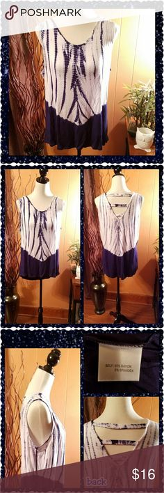 Navy and white tank top This loose fitting tank top is adorable. White and navy blue tie dye on the top and solid navy blue on the bottom. The cutouts on the back give it an interesting look. 95% rayon, 5% spandex. New with tag. Rose & Olive Tops Tank Tops