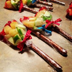 Easy Cinco de Mayo snack for kids (and adults)! Choose your favorite red, yellow & green fruit or other snack, layer in a 6 x 3.75 treat bag then seal, and affix to a wrapped pretzel rod (I used Saran Wrap)!