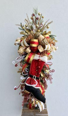 Fancy Santa door swag designed by Arcadia Floral & Home Decor