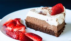 A decadent triple chocolate strawberry mousse cake that is perfect for a special occasion. Decadent, divine, amazing chocolate mousse cake.