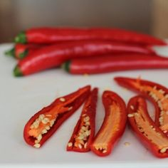 Control a dish's spiciness by adding more or fewer chili seeds. Thai Cooking, Cooking Tips, Asian Recipes, Ethnic Recipes, Pepper Seeds, Spicy Chili, Fresh Lime Juice, Roasted Garlic, Stuffed Hot Peppers
