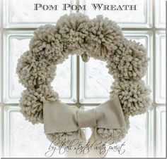 Anthropologie-inspired pom-pom wreath. Change up the color for each season or holiday. #DIY #tutorial