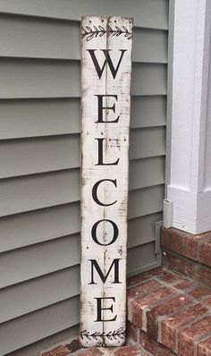 Welcome is hand painted on reclaimed pallet wood. Letters are dark walnut stain. Background is antique white. Sign measures 7 wide by 42-44