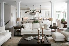 traditional living room white and oil rubbed bronze, slipcovered sofas