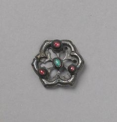 Ring Brooch  Date: first half of 14th century  Medium: Silver, turquoise, glass paste  Dimensions:  Overall Diameter: 1 1/8 in. (2.9 cm)  The Cloisters Collection, 1957  Accession Number:  57.26.2  This artwork is currently on display in Gallery 01