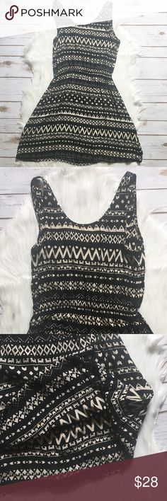 """B&W Cut Out Back Dress Black and white geometric print dress. Elastic waist. Scoop neck in front. V-neck in back, with triangle cut-out above waist. Single button closure in back above cut-out. 100% Rayon. Brand unknown. Measurements on one side when laid flat: Length about 31"""" from top of shoulder to hem. Underarm to underarm about 15.5"""". Hem about 25"""" wide. In excellent condition. Dresses"""