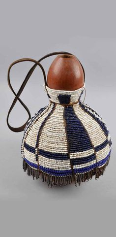 Africa | Storage container from the Kamba people of Kenya; gourd, glass beads, leather | ca. 1904 or earlier