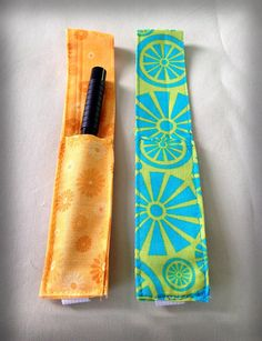 No need to keep looking for that pen at the bottom of your purse!  These super-practical pen holders are made with cotton fabric, and held on the cover