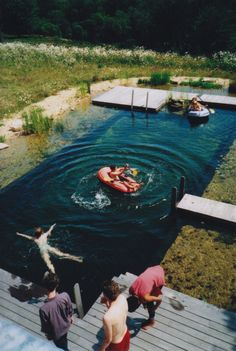This is one of the coolest pools...looks like a pond and has piers.  I totally would love this.