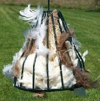 Birdie Bell is a sturdy wire bell shape filled with a variety of nesting material that birds love: Cotton, String, Feathers, Hemp and Aspen Fiber. It can be refilled with nesting material or can hold