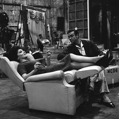 Gina Lollobrigida and Sean Connery take a break during the filming of Woman of Straw- 1964