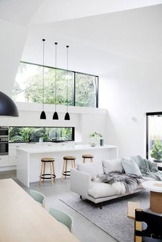 Like desk in kitchen. Open floor plan is a yes. Black Hanging lights is good but wouldn't want sofa not facing kitchen