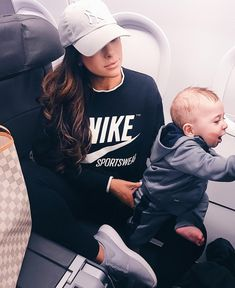 December & January Mega Insta-Recap – The Sweetest Thing. Black Nike Sweatshirt | Grey Tennis Shoes, Women's Nike Roshe Two Casual Shoes | NY Gray Cap | airport outfit, long flights fashion, what to wear for a long flight, plane outfit.