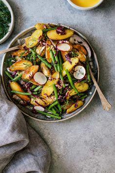 Potato Salad w/ Saffron Aioli   HonestlyYUM (honestlyyum.com) #recipes #salads #picnics #veggies #saladdressing