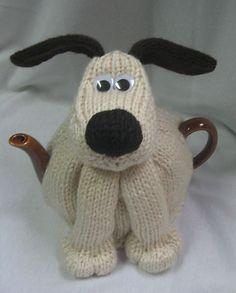 Ravelry: Dog Tea Cosy pattern by Rian Anderson  It looks like Grommet!