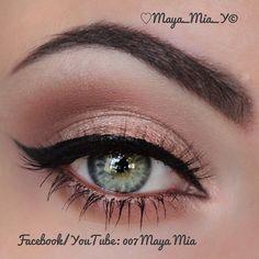 Rose gold eyeshadow makes blue green eyes pop