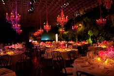 Pink and purple crystal chandeliers hung above the gala dinner's round tables. Photo: Alice and Chris for BizBash