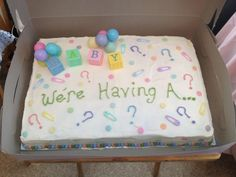 Gender reveal cake with the cake pink or blue to reveal baby gender at a gender reveal party! Love this!