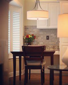 A  #DrumShade #pendant provides beautiful #ambient #kitchen #lighting. #DesignTip #InteriorDesign #Inspiration