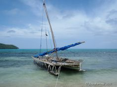 """""""Relaxing After Sail Trip"""" Sailing canoe captured in Papua New Guinea, Louisiade Archipelago, Nirvani Is. Residents in the more remote islands of the Louisiade Archipelago rely heavily at the present on this sailing canoes (sailau in the local Misima language) as a basic means of transport. Sailing canoes are used to move between islands, to transport goods and cargo, and to access fishing grounds. The planked canoes vary in length from 4–12 m and carry a single outrigger."""