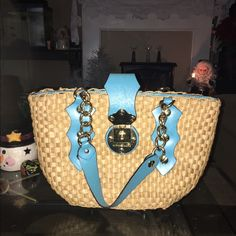 Michael Kors santorini straw shopper tote Michael Kors straw shopper tote. Turquoise leather. Gold hardware. I have the tag but it is not attached. Feel free to ask any additional questions. Cheaper on merc  :-) Michael Kors Bags Shoulder Bags