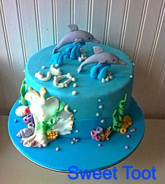 Edible Gum Paste Dolphin Cake Toppers by SweetPerfectionCakes