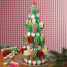 Ingredients        1 cup vanilla frosting      Green liquid or paste food coloring        Styrofoam cone (12 inches high)      15 hard peppermint candies      15 hard spearmint candies      19 large red gumdrops      19 large green gumdrops      25 to 35 pieces crimped ribbon candy      23 pieces cut rock candy