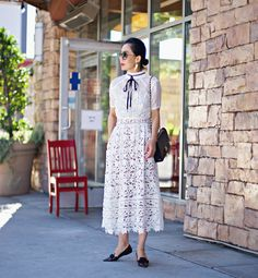 Hallie Daily. fashion blogger. What I wore: Self Portrait Lace Dress /Jimmy Choo Bow Point-toe Flats /Miu Miu Sunglasses /Chanel 2.55 Bag / Lace Top with Bow Tie / Victoria Road Earrings(c/o)