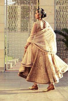 Mughal inspired gold and cream anarkali.  TARUN TAHILIANI'S MAGNIFICENT 2014-2015 BRIDAL COLLECTION