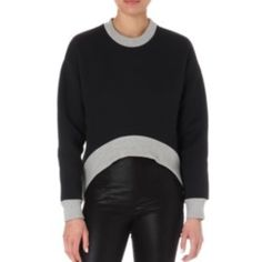 "ETRE CECILE Neoprene crop-front sweatshirt Être Cécile neoprene sweatshirt. Slips on. Round neck, long sleeves, dropped shoulders, cropped front, contrast ribbed trims. 64% polyester, 24% polyethylene, 2% polyurethane. Dry clean. True to size. Size small: Length 27"" Model is 5ft 10"" and wears a size small. Made in Portugal. Etre Cecile Sweaters Crew & Scoop Necks"
